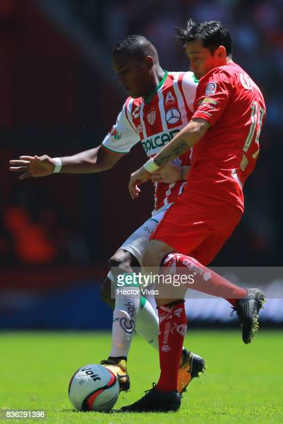 Brayan Beckeles of Necaxa struggles for the ball with Rubens Sambueza of Toluca during the fifth round match between Toluca and Necaxa as part of the...