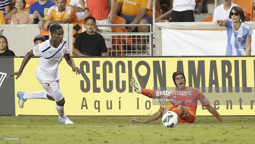 Brayan Beckles of Olimpia shoves Calen Carr of the Houston Dynamo off the ball at BBVA Compass Stadium during the CONCACAF League Champions...