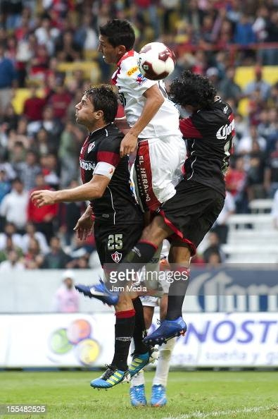 Brayan Martinez Facundo Erpen of Atlas and Brayan Martinez of Puebla fight for the ball during a match between Atlas and Puebla as part of the...