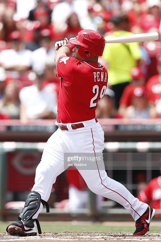 <a gi-track='captionPersonalityLinkClicked' href=/galleries/search?phrase=Brayan+Pena&family=editorial&specificpeople=545678 ng-click='$event.stopPropagation()'>Brayan Pena</a> #29 of the Cincinnati Reds doubles to drive in a run in the first inning of the game against the Chicago Cubs at Great American Ball Park on July 10, 2014 in Cincinnati, Ohio.
