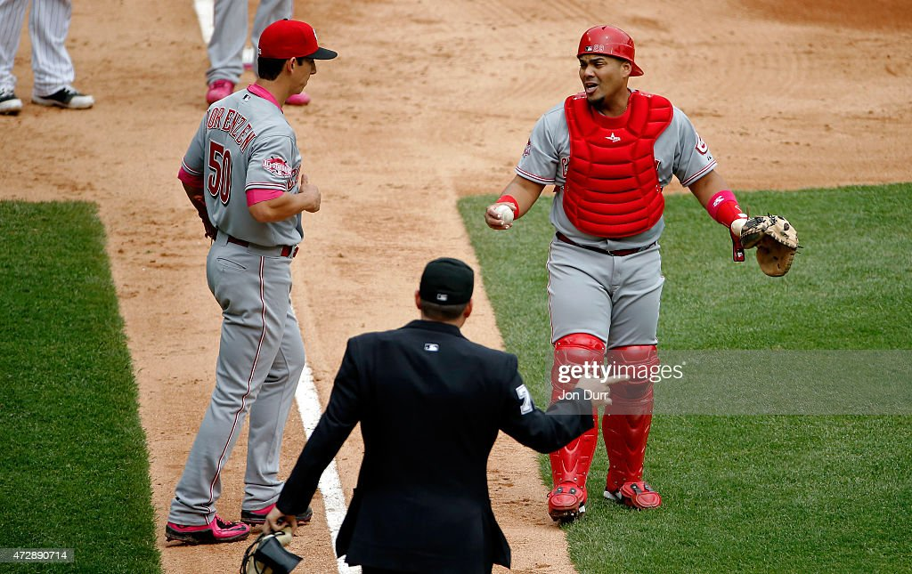 Brayan Pena #29 of the Cincinnati Reds reacts next to Michael Lorenzen #50 after a bunt by Emilio Bonifacio #64 of the Chicago White Sox (not pictured) was called in fair territory during the fourth inning on May 10, 2015 at U.S. Cellular Field in Chicago, Illinois.