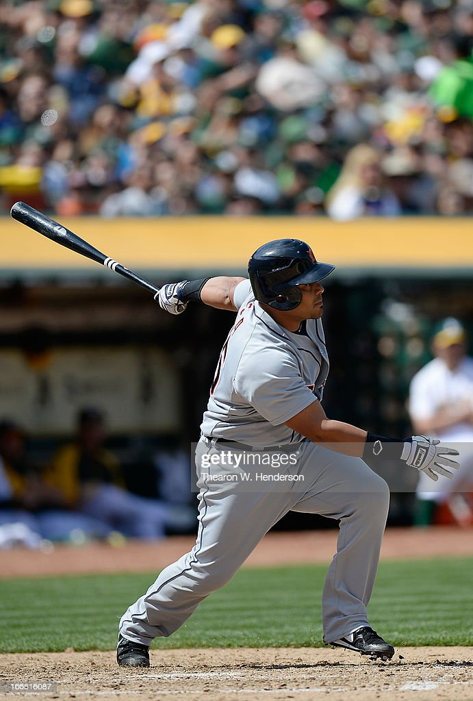 <a gi-track='captionPersonalityLinkClicked' href=/galleries/search?phrase=Brayan+Pena&family=editorial&specificpeople=545678 ng-click='$event.stopPropagation()'>Brayan Pena</a> #55 of the Detroit Tigers hits an RBI double, driving in Omar Infante #4 against the Oakland Athletics in the six inning at O.co Coliseum on April 13, 2013 in Oakland, California.
