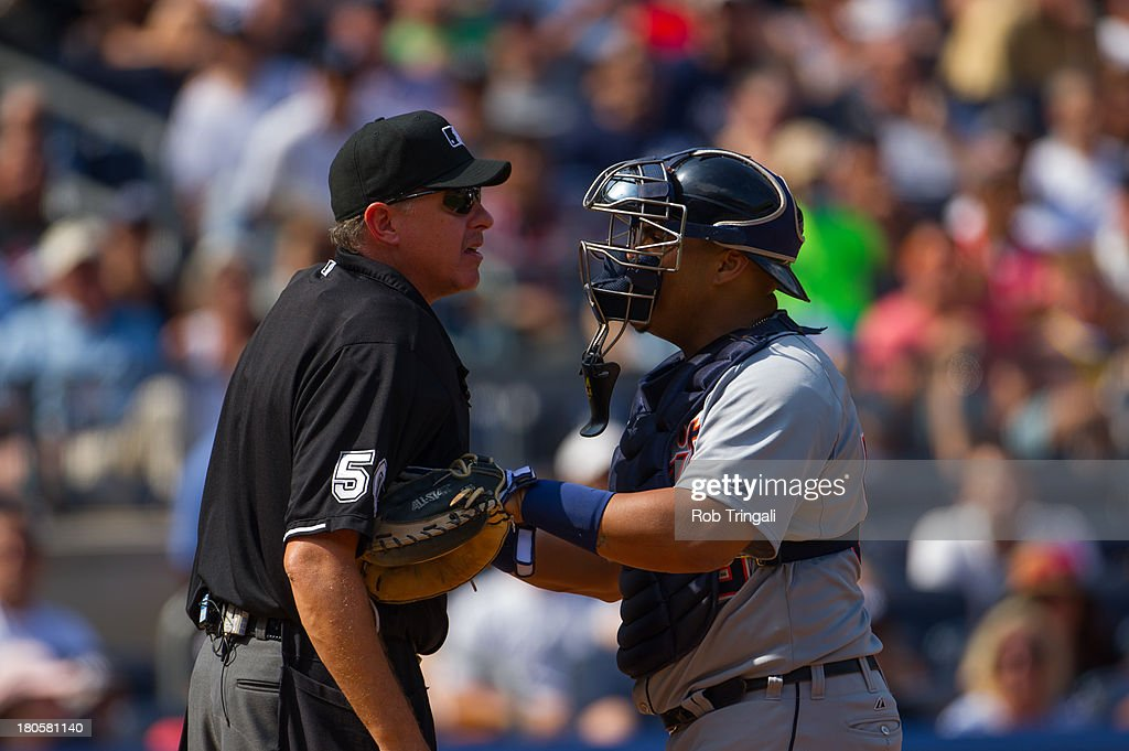 Brayan Pena #55 of the Detroit Tigers holds back home plate umpire after an argument over a call made during the game at Yankee Stadium on August 11, 2013 in the Bronx borough of Manhattan.