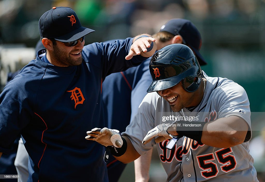<a gi-track='captionPersonalityLinkClicked' href=/galleries/search?phrase=Brayan+Pena&family=editorial&specificpeople=545678 ng-click='$event.stopPropagation()'>Brayan Pena</a> #55 of the Detroit Tigers is congratulated by <a gi-track='captionPersonalityLinkClicked' href=/galleries/search?phrase=Alex+Avila&family=editorial&specificpeople=5749211 ng-click='$event.stopPropagation()'>Alex Avila</a> #13 after Pena scored against the Oakland Athletics in the six inning at O.co Coliseum on April 13, 2013 in Oakland, California.