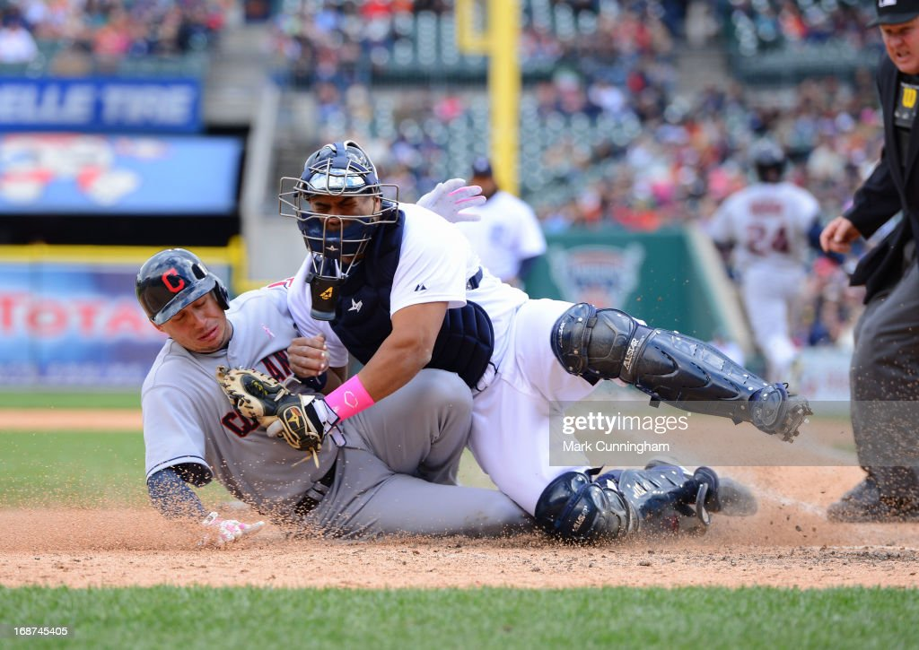 <a gi-track='captionPersonalityLinkClicked' href=/galleries/search?phrase=Brayan+Pena&family=editorial&specificpeople=545678 ng-click='$event.stopPropagation()'>Brayan Pena</a> #55 of the Detroit Tigers tags out <a gi-track='captionPersonalityLinkClicked' href=/galleries/search?phrase=Asdrubal+Cabrera&family=editorial&specificpeople=834042 ng-click='$event.stopPropagation()'>Asdrubal Cabrera</a> #13 of the Cleveland Indians on a play at the plate during the game at Comerica Park on May 12, 2013 in Detroit, Michigan. The Indians defeated the Tigers 4-3.