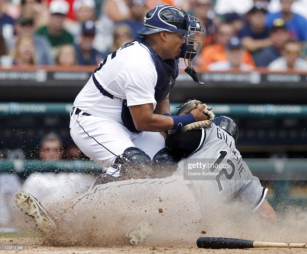 <a gi-track='captionPersonalityLinkClicked' href=/galleries/search?phrase=Brayan+Pena&family=editorial&specificpeople=545678 ng-click='$event.stopPropagation()'>Brayan Pena</a> #55 of the Detroit Tigers tags out <a gi-track='captionPersonalityLinkClicked' href=/galleries/search?phrase=Conor+Gillaspie&family=editorial&specificpeople=5115369 ng-click='$event.stopPropagation()'>Conor Gillaspie</a> #12 of the Chicago White Sox at home plate trying to score from third base on a hit by Gordon Beckham in the ninth inning at Comerica Park on July 11, 2013 in Detroit, Michigan.