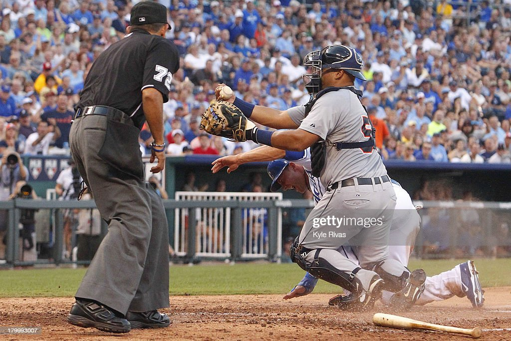<a gi-track='captionPersonalityLinkClicked' href=/galleries/search?phrase=Brayan+Pena&family=editorial&specificpeople=545678 ng-click='$event.stopPropagation()'>Brayan Pena</a> #55 of the Detroit Tigers tags out <a gi-track='captionPersonalityLinkClicked' href=/galleries/search?phrase=David+Lough&family=editorial&specificpeople=6780100 ng-click='$event.stopPropagation()'>David Lough</a> #7 of the Kansas City Royals at the plate third inning on September 7, 2013 at Kauffman Stadium in Kansas City, Missouri.