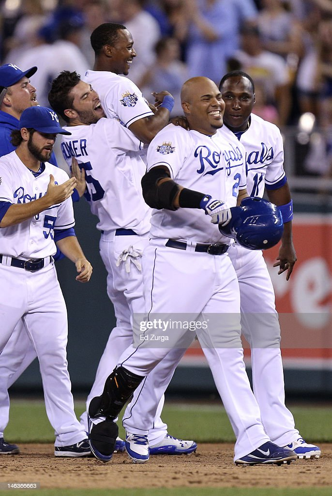 Brayan Pena #27 of the Kansas City Royals is congratulated by Yuniesky Betancourt #11 after driving in the game-winning run during an interleague game against the Milwaukee Brewers at Kauffman Stadium on June 14, 2012 in Kansas City, Missouri.