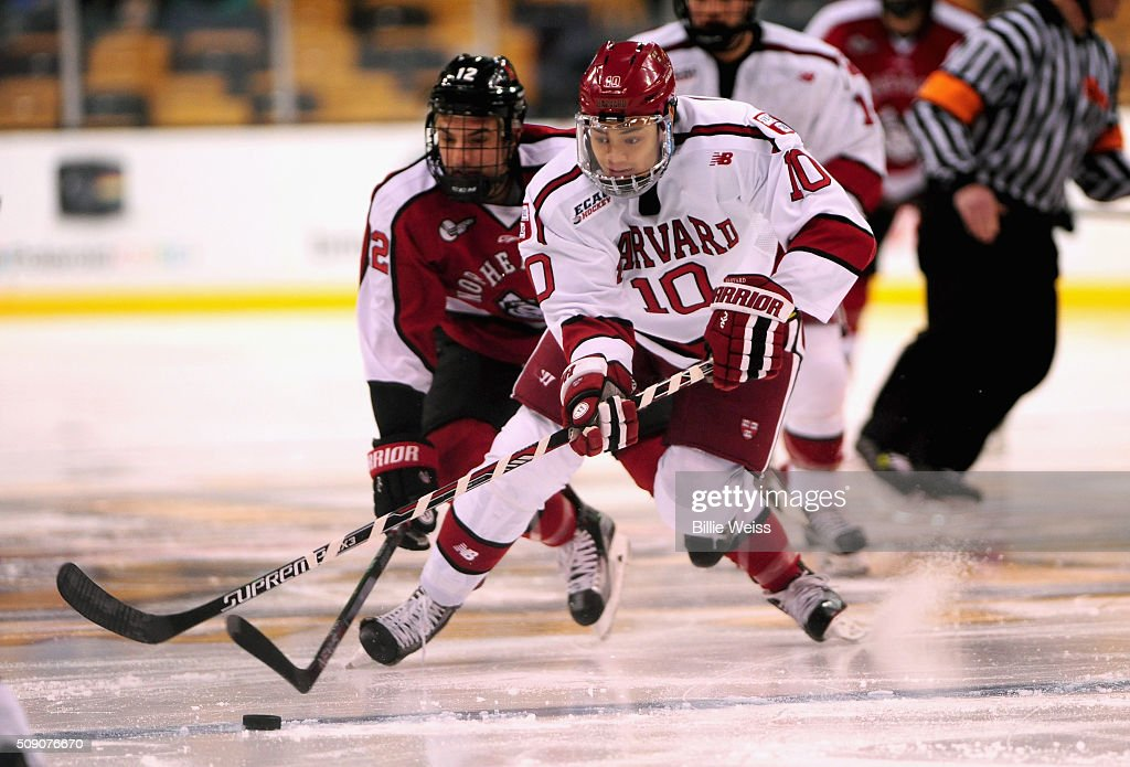 Braydan Jaw #10 of Harvard University handles the puck during the first period of the Beanpot Tournament consolation game against Northeastern University at TD Garden on February 8, 2016 in Boston, Massachusetts.