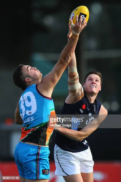 Brayden CROSSLEY of the Allies and Hayden McLean of Vic Metro compete for the ball during the U18 AFL Championships match between Vic Metro and the...