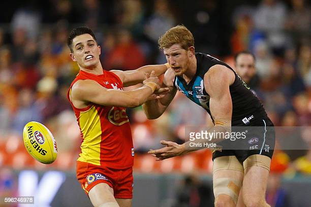 Brayden Fiorini of the Suns and Matthew Lobbe of the Powere compete for the ball during the round 23 AFL match between the Gold Coast Suns and the...