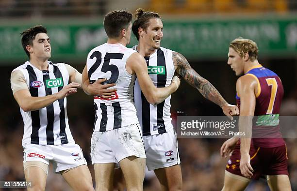 Brayden Maynard Jack Crisp and Jesse White of the Magpies celebrate during the 2016 AFL Round 08 match between the Brisbane Lions and the Collingwood...