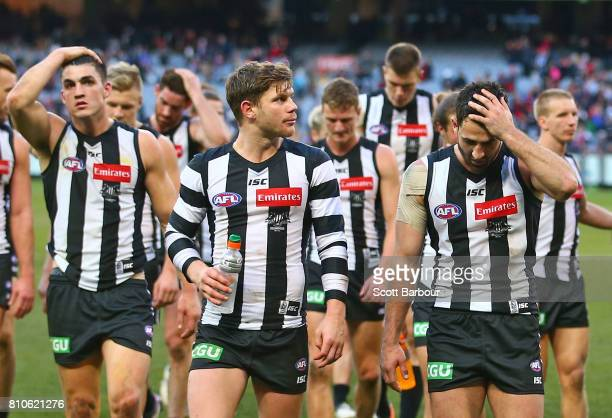 Brayden Maynard of the Magpies Taylor Adams of the Magpies Alex Fasolo of the Magpies and their teammates leave the field after losing the round 16...