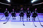 Brayden McNabb Andrej Sekera Jeff Carter Trevor Lewis and Tyler Toffoli of the Los Angeles Kings look on before a game against the Arizona Coyotes at...