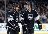 Brayden McNabb of the Los Angeles Kings and Slava Voynov discuss play during a 41 win over the Winnipeg Jets at Staples Center on October 12 2014 in...