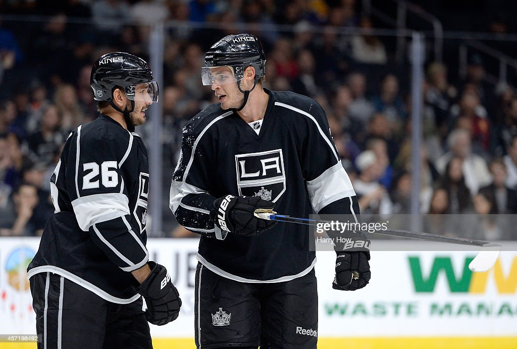 Brayden McNabb #3 of the Los Angeles Kings and Slava Voynov #26 discuss play during a 4-1 win over the Winnipeg Jets at Staples Center on October 12, 2014 in Los Angeles, California.