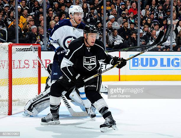Brayden McNabb of the Los Angeles Kings battles for position against Adam Lowry of the Winnipeg Jets on April 9 2016 at STAPLES Center in Los Angeles...