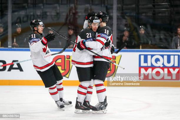 Brayden Point of Canada celebrates his goal with Mitch Marner and Travis Konecny of Canada during the 2017 IIHF Ice Hockey World Championship game...