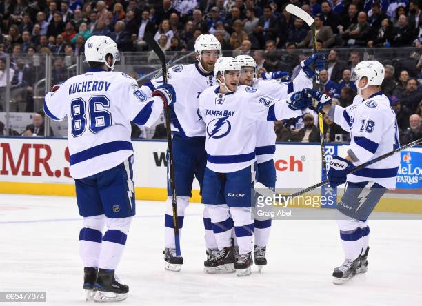 Brayden Point of the Tampa Bay Lightning celebrates his goal on the Toronto Maple Leafs with teammates Nikita Kucherov Victor Hedman Ondrej Palat and...