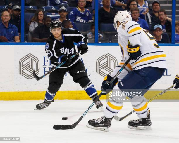 Brayden Point of the Tampa Bay Lightning has his pass deflected for a goal by Rasmus Ristolainen of the Buffalo Sabres during third period at Amalie...