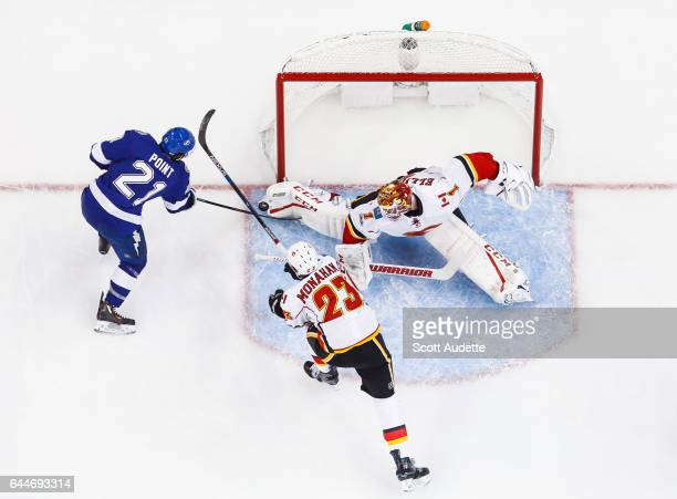 Brayden Point of the Tampa Bay Lightning shoots the puck against goalie Brian Elliott of the Calgary Flames during the second period at Amalie Arena...