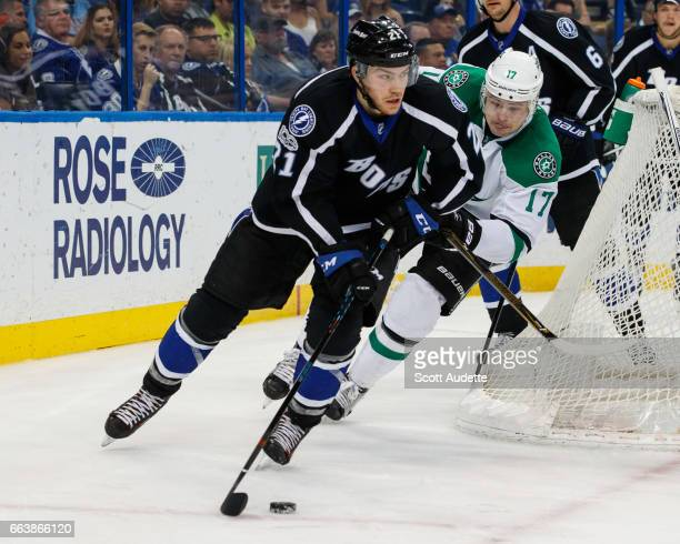 Brayden Point of the Tampa Bay Lightning skates against Devin Shore of the Dallas Stars during second period at Amalie Arena on April 2 2017 in Tampa...