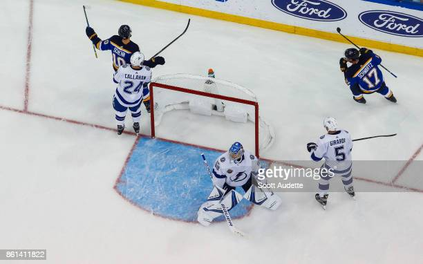 Brayden Schenn and Jaden Schwartz of the St Louis Blues celebrate a goal against goalie Andrei Vasilevskiy and the Tampa Bay Lightning during the...