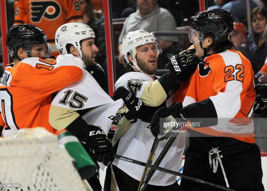 Brayden Schenn #10 and Luke Schenn #22 of the Philadelphia Flyers scuffle with Tanner Glass #15 and Joe Vitale #46 of the Pittsburgh Penguins behind the net on March 15, 2014 at the Wells Fargo Center in Philadelphia, Pennsylvania.