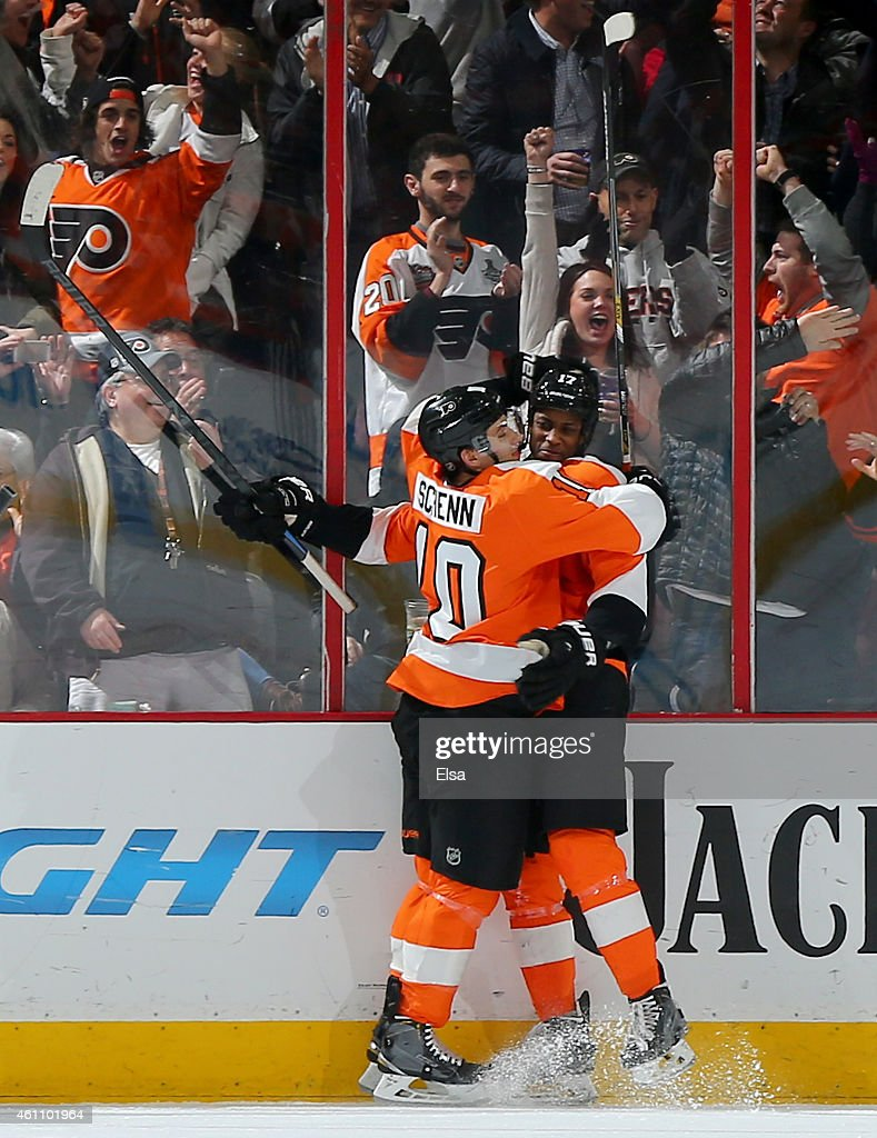 Brayden Schenn #10 congratulates Wayne Simmonds #17 of the Philadelphia Flyers after Simmonds scored a goal in the third period against the Ottawa Senators on January 6, 2015 at the Wells Fargo Center in Philadelphia, Pennsylvania.The Philadelphia Flyers defeated the Ottawa Senators 2-1 in an overtime shootout.