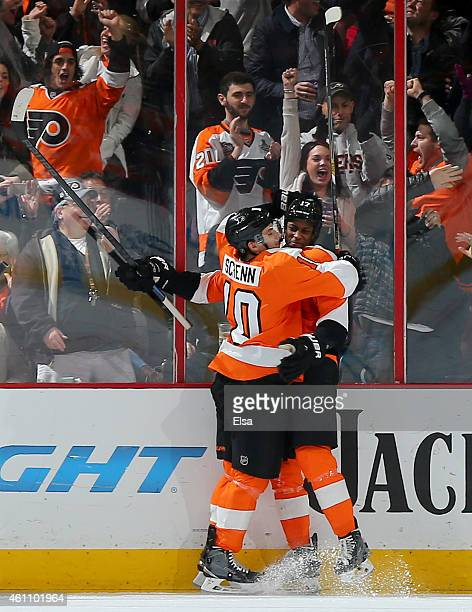 Brayden Schenn congratulates Wayne Simmonds of the Philadelphia Flyers after Simmonds scored a goal in the third period against the Ottawa Senators...