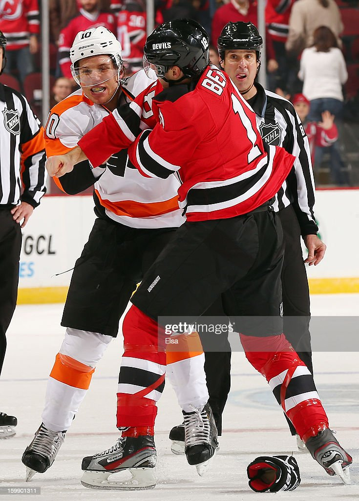 <a gi-track='captionPersonalityLinkClicked' href=/galleries/search?phrase=Brayden+Schenn&family=editorial&specificpeople=4782304 ng-click='$event.stopPropagation()'>Brayden Schenn</a> #10 of the Philadelphia Flyers and <a gi-track='captionPersonalityLinkClicked' href=/galleries/search?phrase=Steve+Bernier&family=editorial&specificpeople=557040 ng-click='$event.stopPropagation()'>Steve Bernier</a> #18 of the New Jersey Devils fight in the third period during the season opener at the Prudential Center on January 22, 2013 in Newark, New Jersey.The New Jersey Devils shut out the Philadelphia Flyers 3-0.
