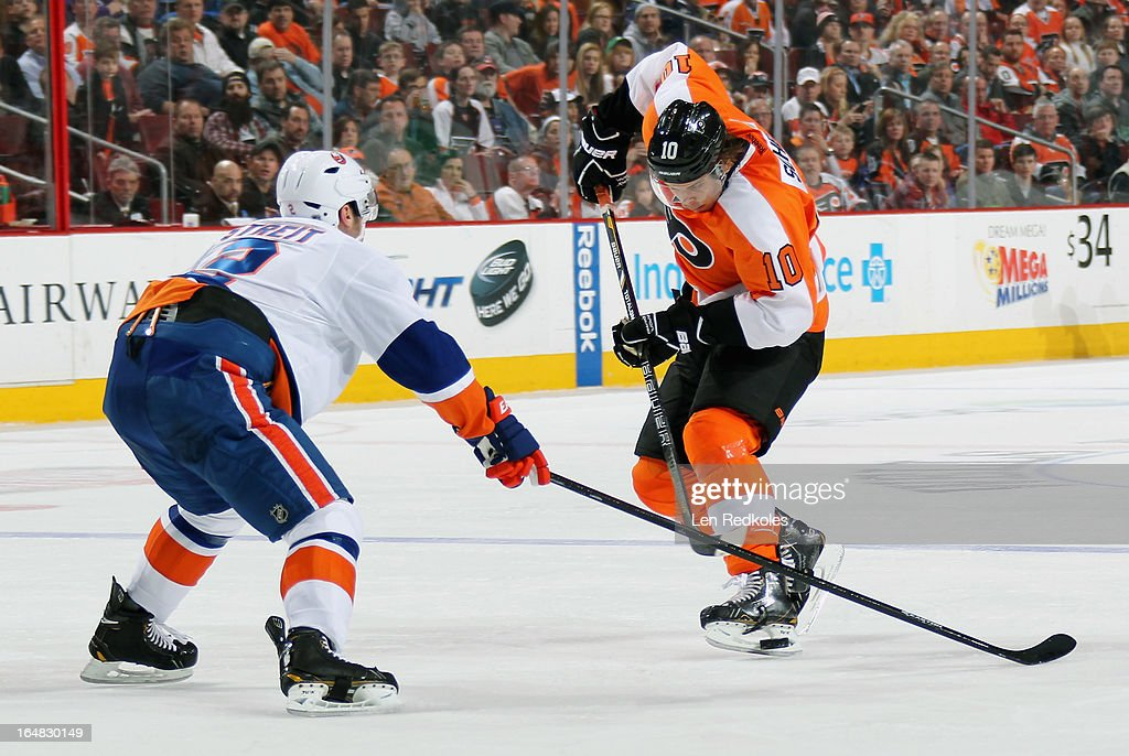 <a gi-track='captionPersonalityLinkClicked' href=/galleries/search?phrase=Brayden+Schenn&family=editorial&specificpeople=4782304 ng-click='$event.stopPropagation()'>Brayden Schenn</a> #10 of the Philadelphia Flyers attempts to get the puck around <a gi-track='captionPersonalityLinkClicked' href=/galleries/search?phrase=Mark+Streit&family=editorial&specificpeople=636976 ng-click='$event.stopPropagation()'>Mark Streit</a> #2 of the New York Islanders on March 28, 2013 at the Wells Fargo Center in Philadelphia, Pennsylvania.