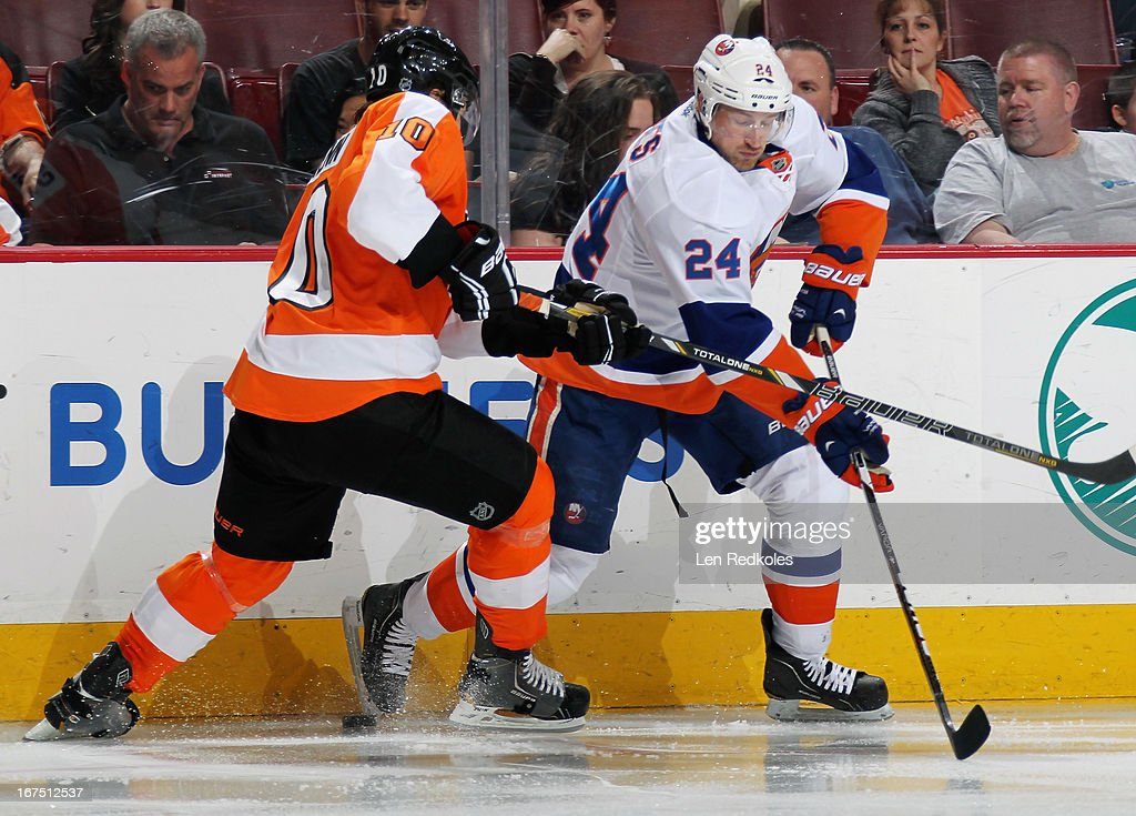 <a gi-track='captionPersonalityLinkClicked' href=/galleries/search?phrase=Brayden+Schenn&family=editorial&specificpeople=4782304 ng-click='$event.stopPropagation()'>Brayden Schenn</a> #10 of the Philadelphia Flyers battles along the boards for the loose puck with <a gi-track='captionPersonalityLinkClicked' href=/galleries/search?phrase=Brad+Boyes&family=editorial&specificpeople=275014 ng-click='$event.stopPropagation()'>Brad Boyes</a> #24 of the New York Islanders on April 25, 2013 at the Wells Fargo Center in Philadelphia, Pennsylvania. The Flyers went on to defeat the Islanders 2-1.