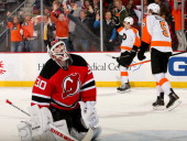 Brayden Schenn of the Philadelphia Flyers celebrates his game winning goal as Martin Brodeur of the New Jersey Devils reacts to the loss at...