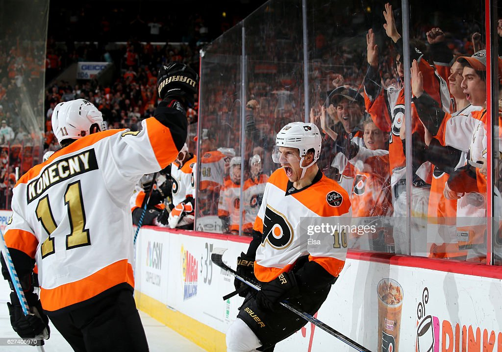 Brayden Schenn #10 of the Philadelphia Flyers celebrates his goal with teammate Travis Konecny #11 in the second period against the Chicago Blackhawks on December 3, 2016 at Wells Fargo Center in Philadelphia, Pennsylvania.