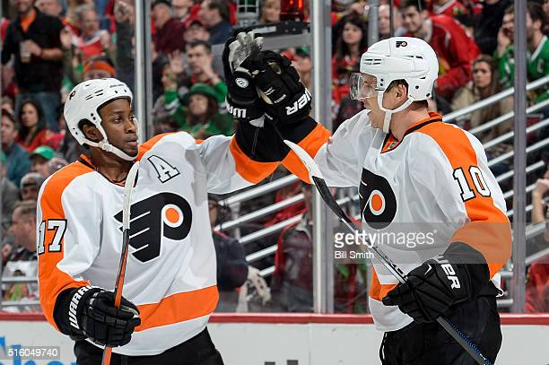 Brayden Schenn of the Philadelphia Flyers celebrates with Wayne Simmonds after scoring against the Chicago Blackhawks in the second period of the NHL...
