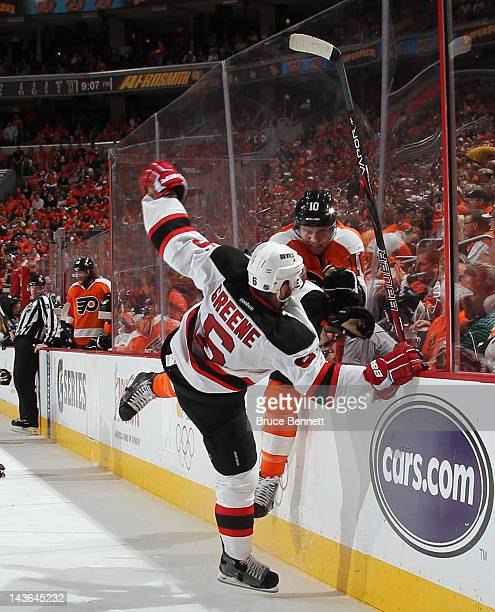 Brayden Schenn of the Philadelphia Flyers hits Andy Greene of the New Jersey Devils during the second period in Game Two of the Eastern Conference...