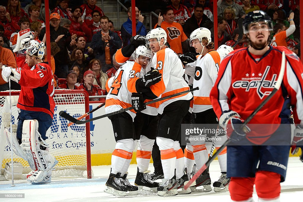 <a gi-track='captionPersonalityLinkClicked' href=/galleries/search?phrase=Brayden+Schenn&family=editorial&specificpeople=4782304 ng-click='$event.stopPropagation()'>Brayden Schenn</a> #10 of the Philadelphia Flyers is congratulate by teammates after scoring in the third period of an NHL hockey game against the Washington Capitals at Verizon Center on February 1, 2013 in Washington, DC.