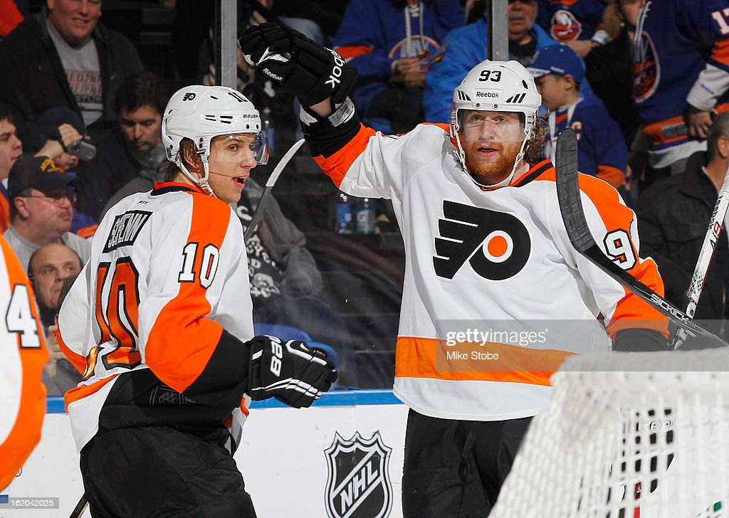Brayden Schenn #10 of the Philadelphia Flyers is congratulated by teammate Jakub Voracek #93 on his second period goal against the New York Islanders at Nassau Veterans Memorial Coliseum on February 18, 2013 in Uniondale, New York.