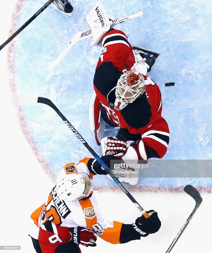 Brayden Schenn #10 of the Philadelphia Flyers misses the attempt against Keith Kinkaid #1 of the New Jersey Devils at the Prudential Center on April 4, 2017 in Newark, New Jersey. The Devils defeated the Flyers 1-0 in overtime.