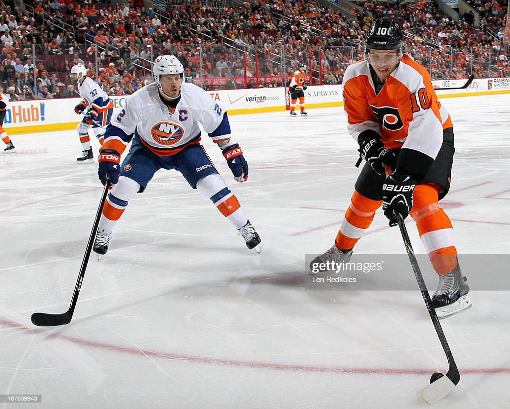 <a gi-track='captionPersonalityLinkClicked' href=/galleries/search?phrase=Brayden+Schenn&family=editorial&specificpeople=4782304 ng-click='$event.stopPropagation()'>Brayden Schenn</a> #10 of the Philadelphia Flyers plays the puck in the corner while being defended by <a gi-track='captionPersonalityLinkClicked' href=/galleries/search?phrase=Mark+Streit&family=editorial&specificpeople=636976 ng-click='$event.stopPropagation()'>Mark Streit</a> #2 of the New York Islanders on April 25, 2013 at the Wells Fargo Center in Philadelphia, Pennsylvania.