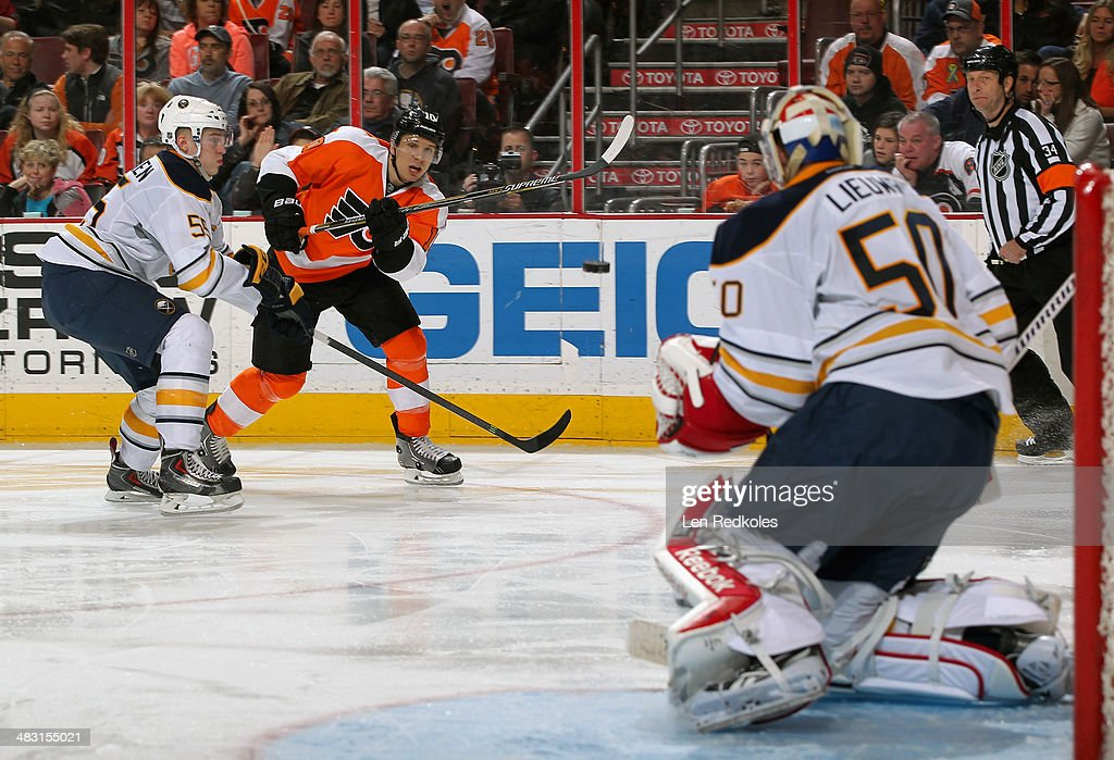 <a gi-track='captionPersonalityLinkClicked' href=/galleries/search?phrase=Brayden+Schenn&family=editorial&specificpeople=4782304 ng-click='$event.stopPropagation()'>Brayden Schenn</a> #10 of the Philadelphia Flyers shoots the puck towards goaltender Nathan Lieuwen #50 of the Buffalo Sabres while being defended by <a gi-track='captionPersonalityLinkClicked' href=/galleries/search?phrase=Rasmus+Ristolainen&family=editorial&specificpeople=8760930 ng-click='$event.stopPropagation()'>Rasmus Ristolainen</a> #50 on April 6, 2014 at the Wells Fargo Center in Philadelphia, Pennsylvania. The Flyers went on to defeat the Sabres 5-2.