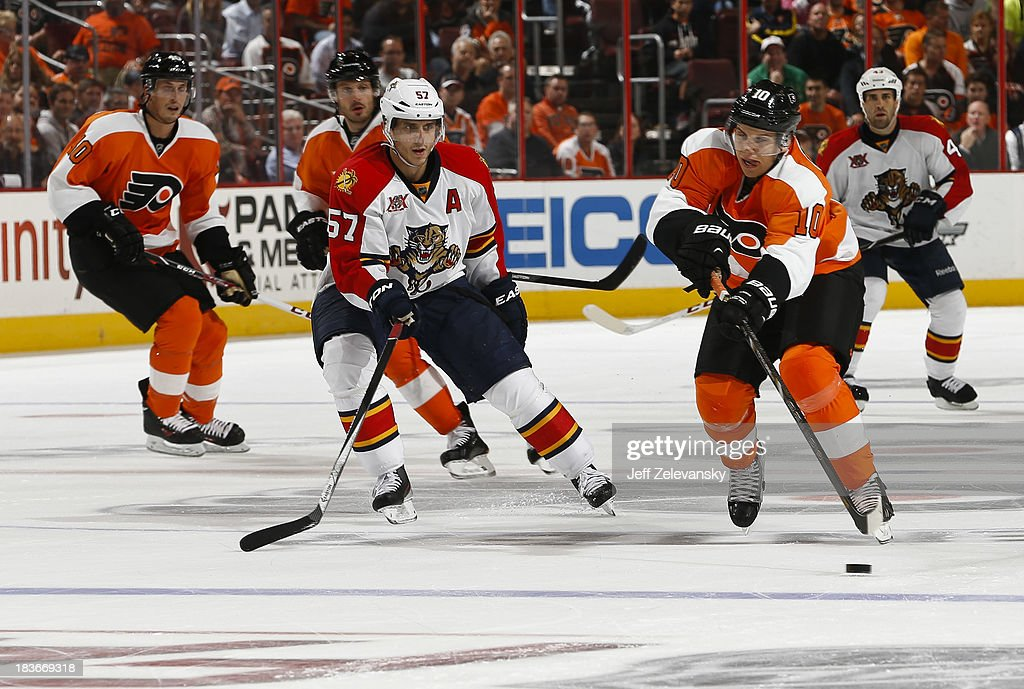 <a gi-track='captionPersonalityLinkClicked' href=/galleries/search?phrase=Brayden+Schenn&family=editorial&specificpeople=4782304 ng-click='$event.stopPropagation()'>Brayden Schenn</a> #10 of the Philadelphia Flyers skates away from <a gi-track='captionPersonalityLinkClicked' href=/galleries/search?phrase=Marcel+Goc&family=editorial&specificpeople=541626 ng-click='$event.stopPropagation()'>Marcel Goc</a> #57 of the Florida Panthers at the Wells Fargo Center on October 8, 2013 in Philadelphia, Pennsylvania.