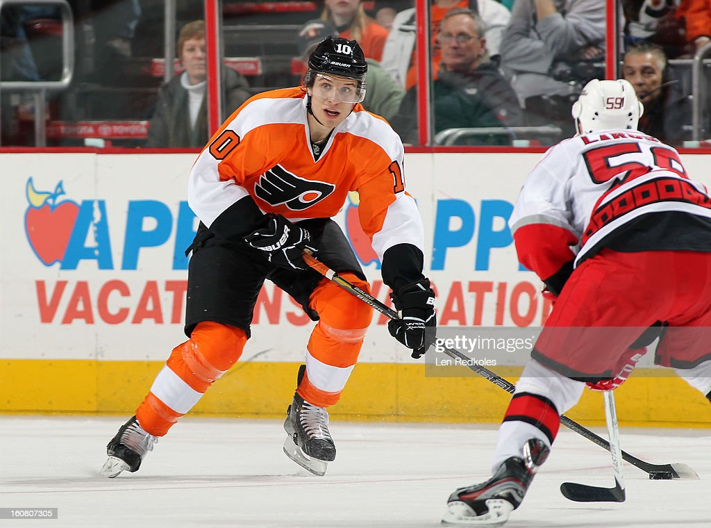 Brayden Schenn #10 of the Philadelphia Flyers skates the puck against Chad Larose #59 of the Carolina Hurricanes on February 2, 2013 at the Wells Fargo Center in Philadelphia, Pennsylvania.