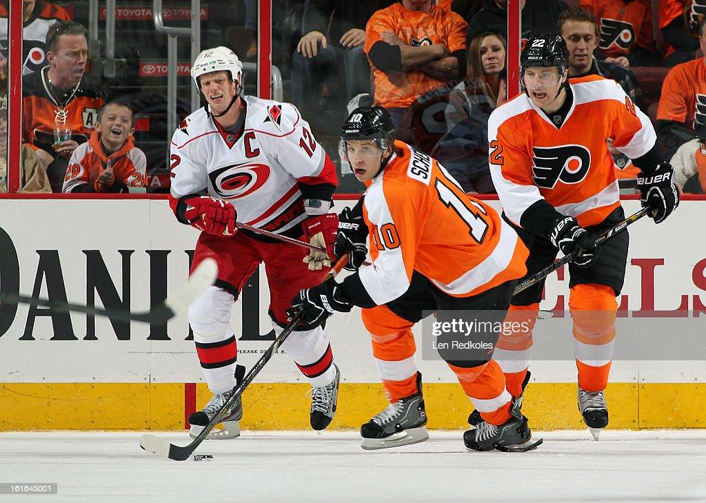 Brayden Schenn #10 of the Philadelphia Flyers skates the puck with Luke Schenn #22 defending Eric Staal #12 of the Carolina Hurricanes on February 9, 2013 at the Wells Fargo Center in Philadelphia, Pennsylvania.