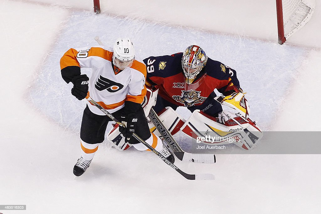 Brayden Schenn of the Philadelphia Flyers takes up position in front of Dan Ellis of the Florida Panthers at the BBT Center on April 8 2014 in...