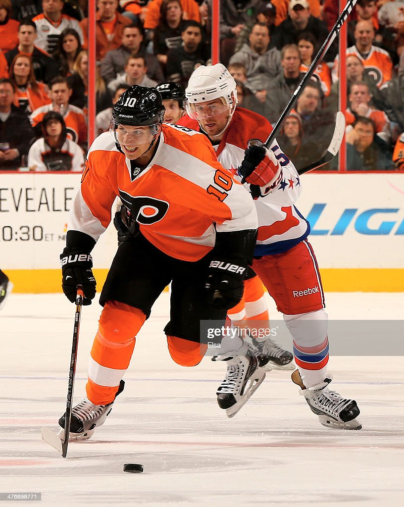 <a gi-track='captionPersonalityLinkClicked' href=/galleries/search?phrase=Brayden+Schenn&family=editorial&specificpeople=4782304 ng-click='$event.stopPropagation()'>Brayden Schenn</a> #10 of the Philadelphia Flyers tries to keep the puck from <a gi-track='captionPersonalityLinkClicked' href=/galleries/search?phrase=Connor+Carrick&family=editorial&specificpeople=9491429 ng-click='$event.stopPropagation()'>Connor Carrick</a> #58 of the Washington Capitals at Wells Fargo Center on March 5, 2014 in Philadelphia, Pennsylvania.