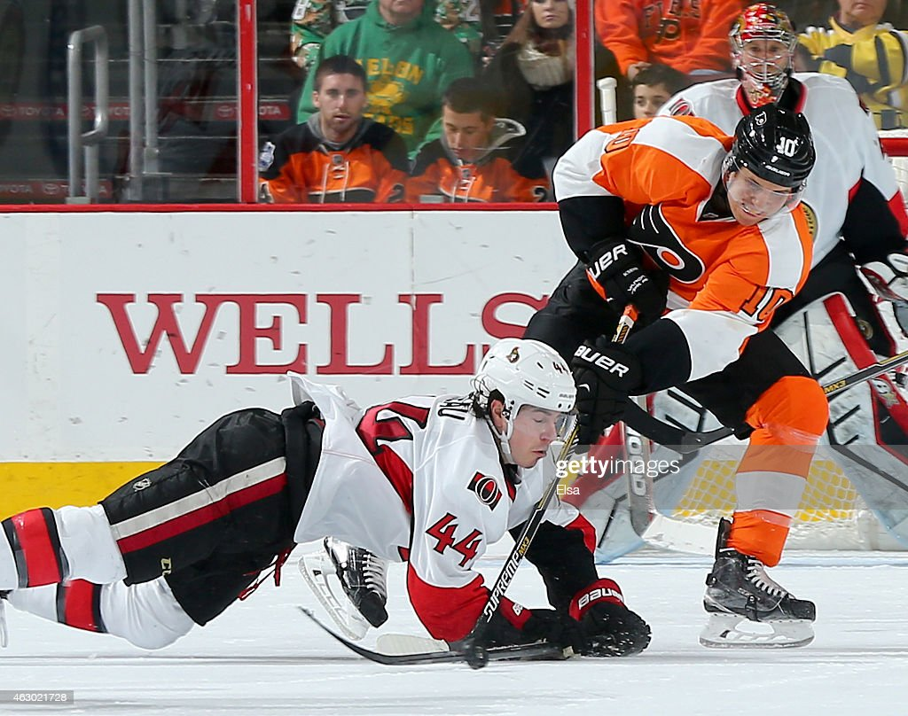 Brayden Schenn #10 of the Philadelphia Flyers tries to pass the puck as Jean-Gabriel Pageau #44 of the Ottawa Senators defends on January 6, 2015 at the Wells Fargo Center in Philadelphia, Pennsylvania.The Philadelphia Flyers defeated the Ottawa Senators 2-1 in an overtime shootout.