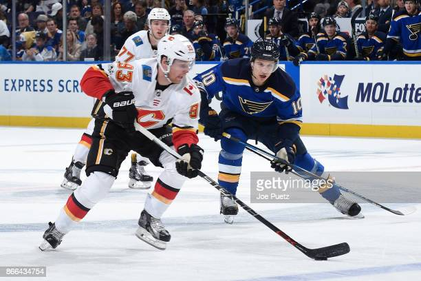 Brayden Schenn of the St Louis Blues defends against Sam Bennett of the Calgary Flames at Scottrade Center on October 25 2017 in St Louis Missouri