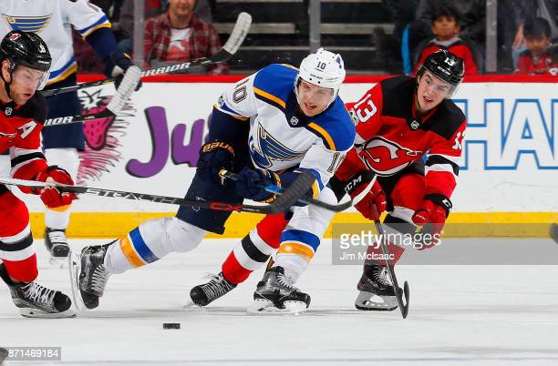 Brayden Schenn of the St Louis Blues plays the puck in the third period against Nico Hischier of the New Jersey Devils on November 7 2017 at...